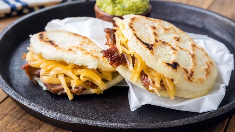 Arepa is a type of food made of ground corn dough or cooked flour prominent.