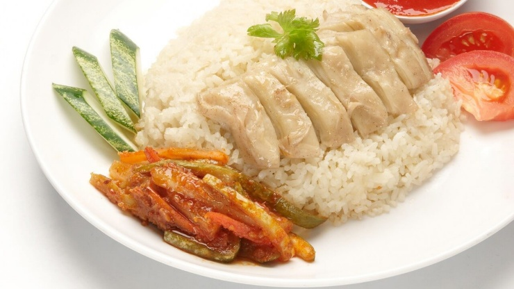 CHICKEN RICE, SINGAPORE This is a dish of poached chicken and seasoned rice, served with chili sauce and garnishes.